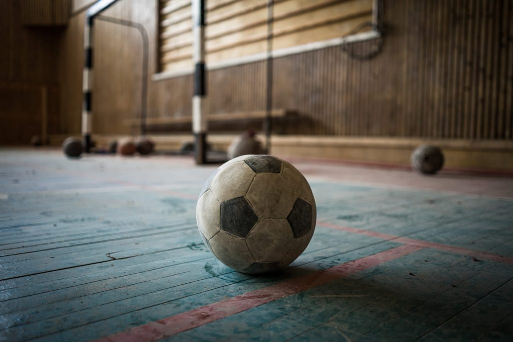 Cleaning your air ducts impacts more than easy breathing. Duct collection can affect your health for years unnoticed. Dust cover a soccer ball in a play room.
