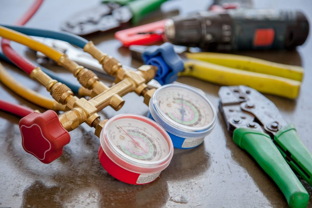 HVAC gauges on a table. You don't have to dismantle your system to fix these common boiler problems.