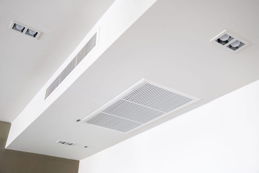 An electronic air cleaner can help with seasonal allergies. A view of an overhead air vent in a clean house.