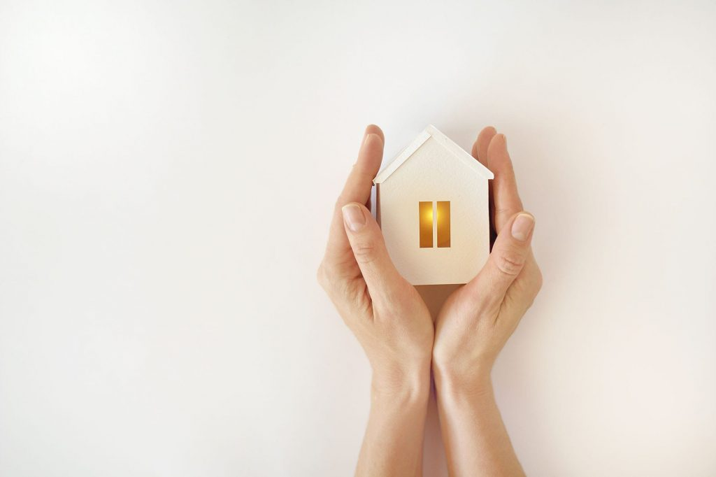 A new hvac installation can make a whole lot of difference to the comfort level of your home. Two hands hold a small wooden house.